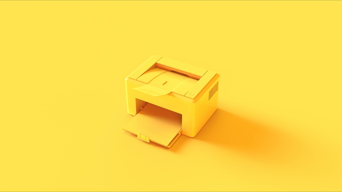 Yellow printer on a yellow background.