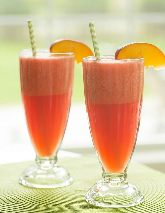 Two glasses full of pink colored watermelon peach slushies.