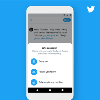 Twitter's new conversation dynamics feature show on a smartphone screen