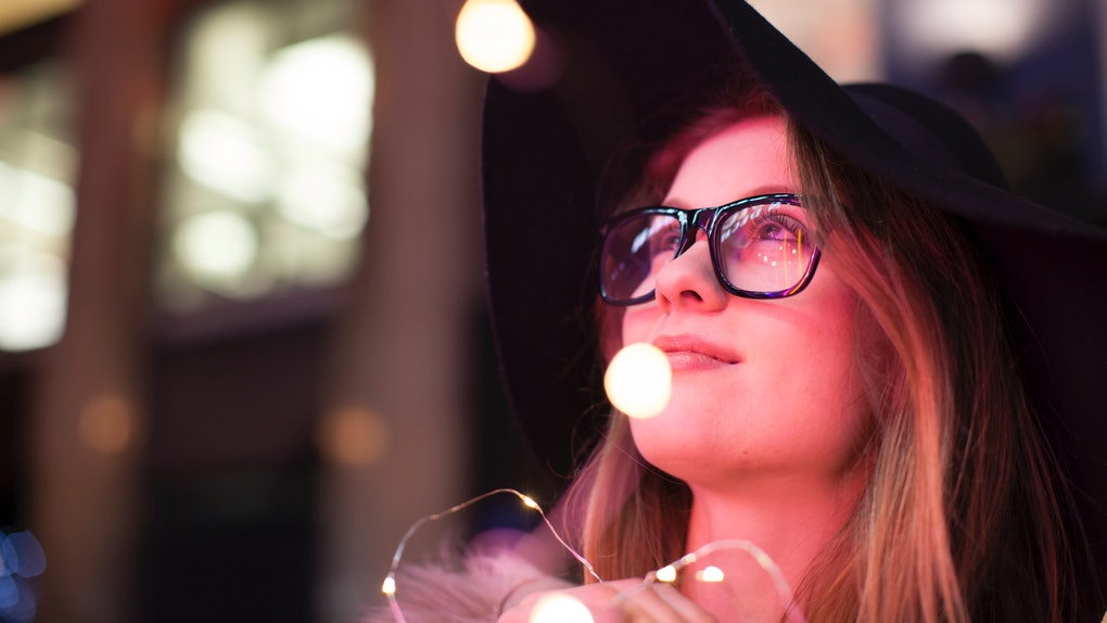 Young woman enjoying bright neon lights of street, London, UK