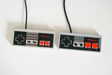 The NES Classic controller next to the Lego version. Note the larger A and B buttons on the Lego replica. Gotta fix that wrongly pieced flat panel.