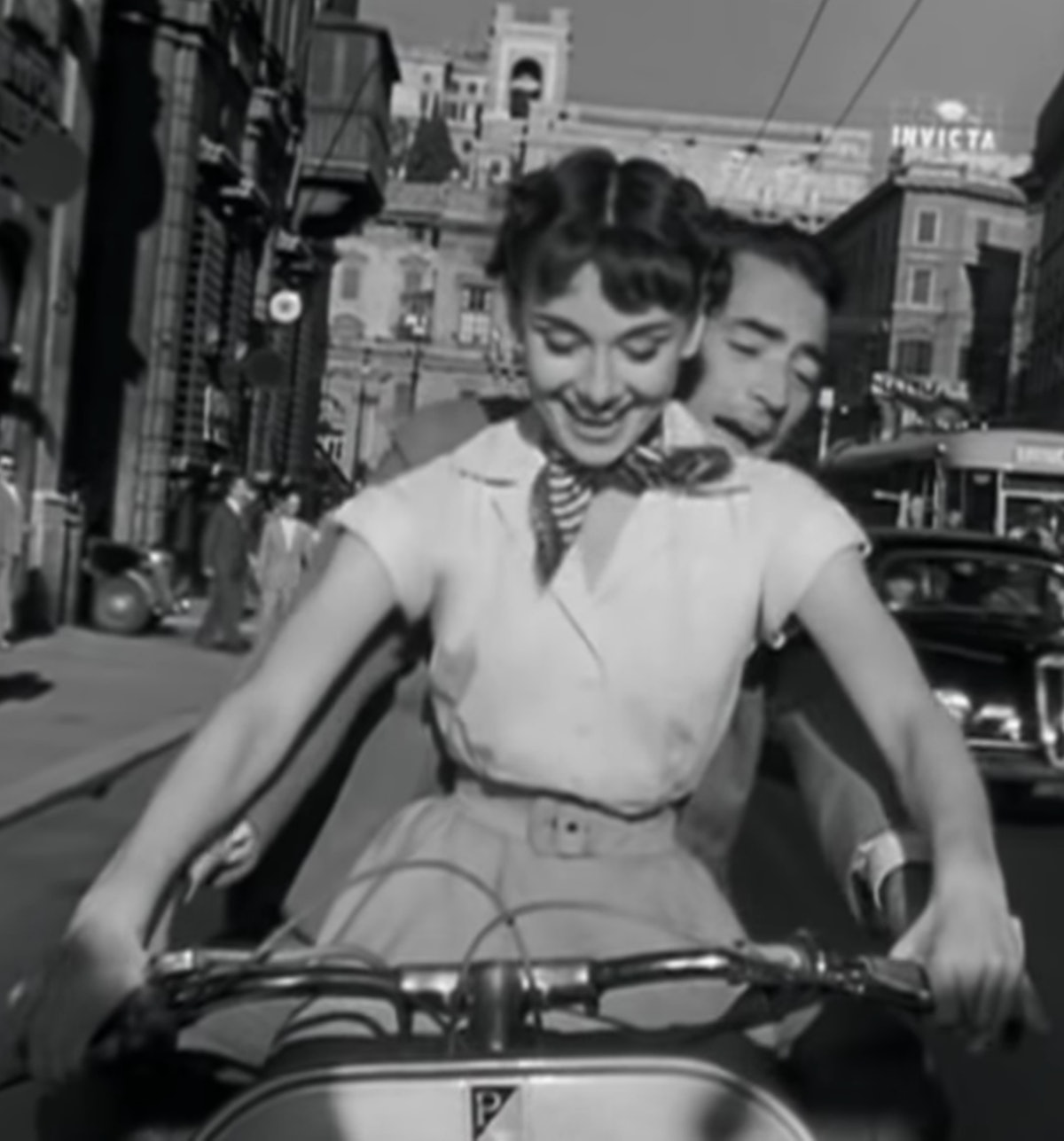 What's more adorable than riding on a Vespa with your partner?