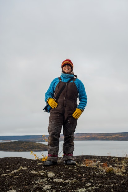Kielyn Marrone stands on a rock by Great Slave Lake in Canada's Northern Territories