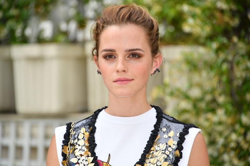 Emma Watson posing against greenery