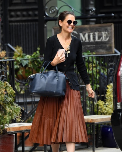 Katie Holmes in a black cardigan and leather brown skirt while in New York City.