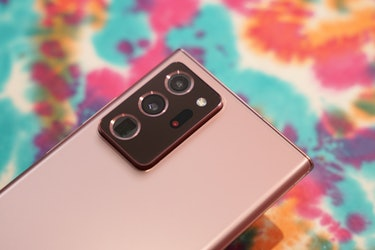See that black pill with the red dot? That's the laser sensor that helps the 108-megapixel main camera focus.