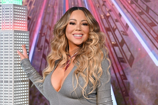 """Mariah Carey lights the Empire State Building in celebration of the 25th anniversary of """"All I Want For Christmas Is You"""" at the Empire State Building on December 17, 2019 in New York City."""