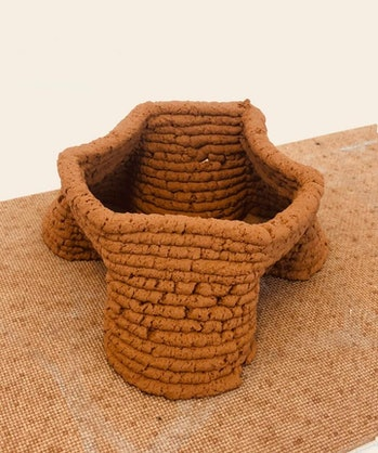 The small structure made out of a colleague's backyard soil.