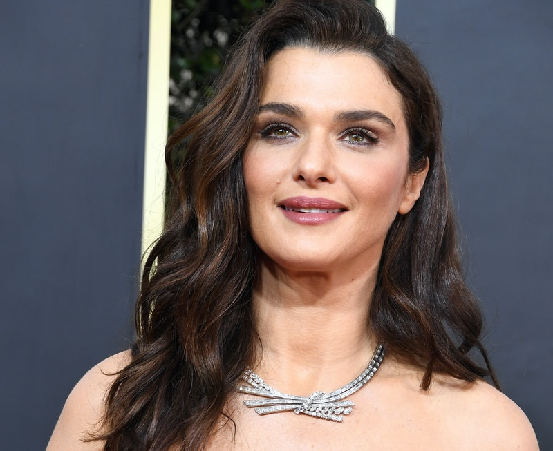 Rachel Weisz on the red carpet wearing an off-the-shoulder dress with a diamond necklace