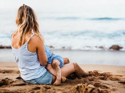 woman breastfeeding on the beach