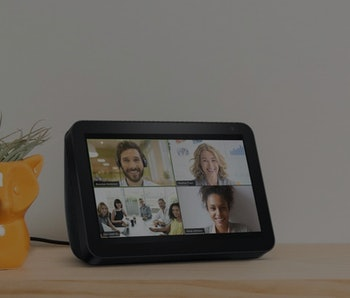 Four people video-conference on an Amazon Echo Show device.