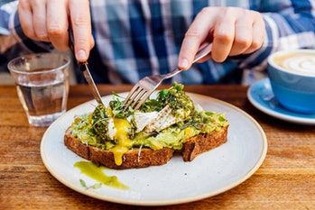 Man eating avocado toast.