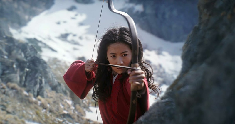 Liu Yifei as Mulan holding a bow and arrrow in a still from the film