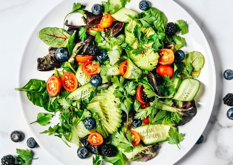 A plate of fresh salad on a white background.