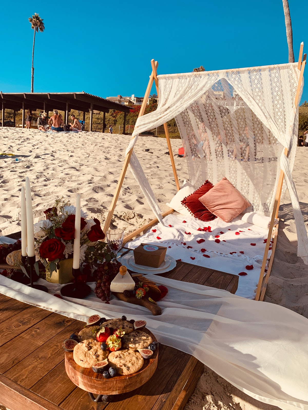 """The Picnic Collective's """"Bliss"""" package includes an intimate set-up on the beach for your and your SO, and lots of wine, cheese, and chocolate."""