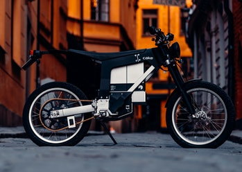 A side view of a Cake Ink SL electric motorcycle