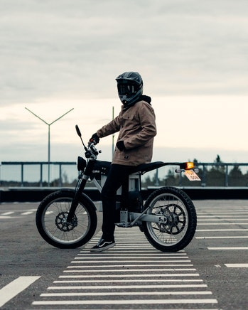 A Cake Ink SL electric motorcycle with a rider
