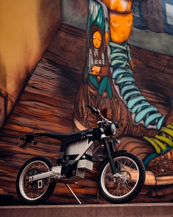 A Cake Ink SL parked in front of a mural