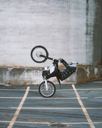 The Cake Kalk Ink electric motorcycle doing a wheelie