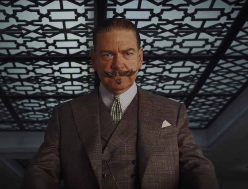 Kenneth Branagh as Hercule Poirot with a large moustache, wearing a suit