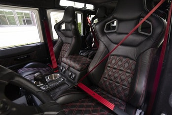 The driver and passenger seats in an electric Defender.