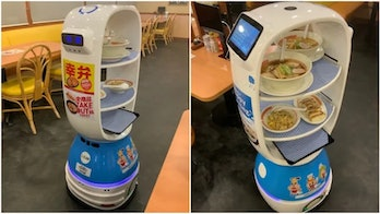 A machine called K-1 can be seen with two shelves carrying separate bowls of ramen. The bottom half of the robot is blue. There is a sitting area behind K-1.