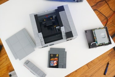 Remove the top cover from the Lego NES.