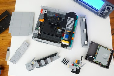 Carefully remove the pieces that make up the walls of the Lego NES to allow you to yank out the cartridge mechanism.