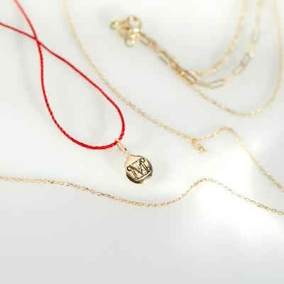 The Met Button Souvenir Charm