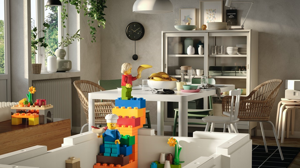 An image of the new Bygglek Ikea Lego and Lego Storage kit in the foreground, with a minifigure chef, LEGO plants and toys.