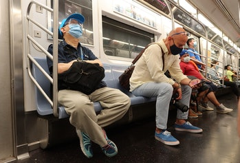 People on the 7 train in NYC wearing masks.
