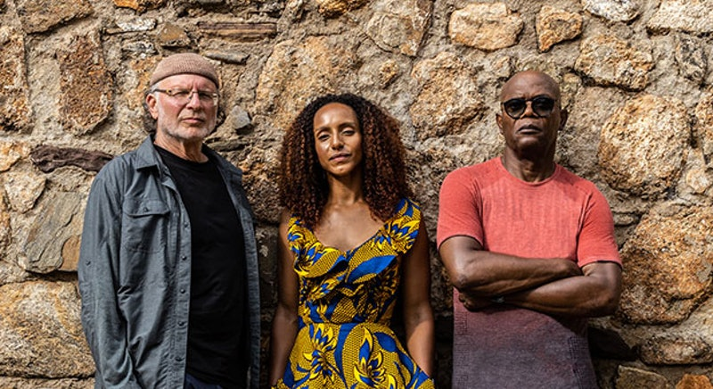 Investigative journalist Simcha Jacobovici, author and Guardian writer Afua Hirsch, actor Samuel L. Jackson stand together in front of a stone wall
