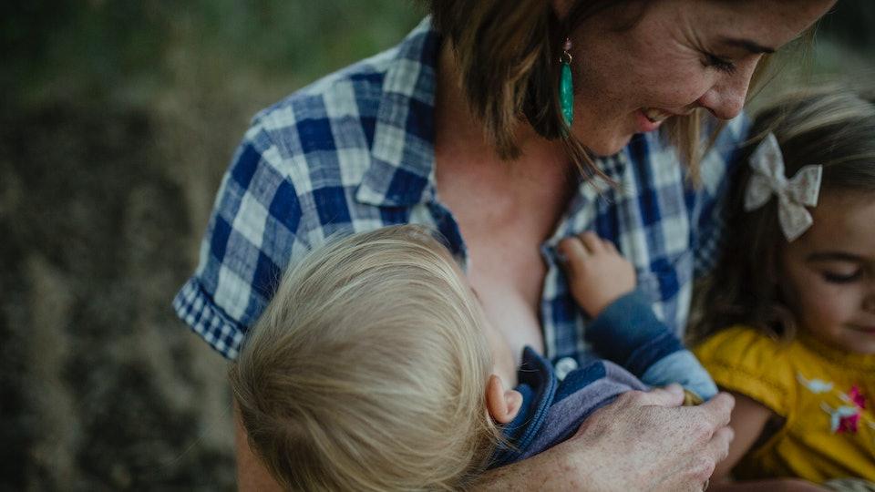 Woman breastfeeding in a cute top