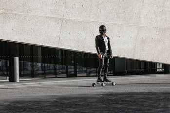 A person in a helmet riding a Hunter Board