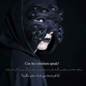 "A woman in a deep blue face mask can be seen. The mask has green eyes on it. The text at the bottom reads: ""Can the subaltern speak?"" In Farsi, it reads: """"Ayah firodast mi toowanid sakhan beguwid?"""