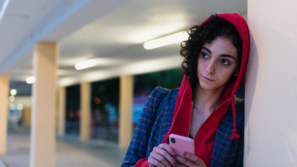Secretive woman texting