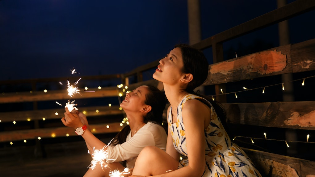 2 young women with fireworks