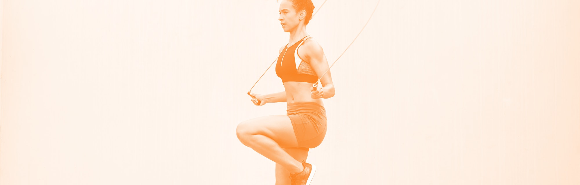Girl jumping rope.