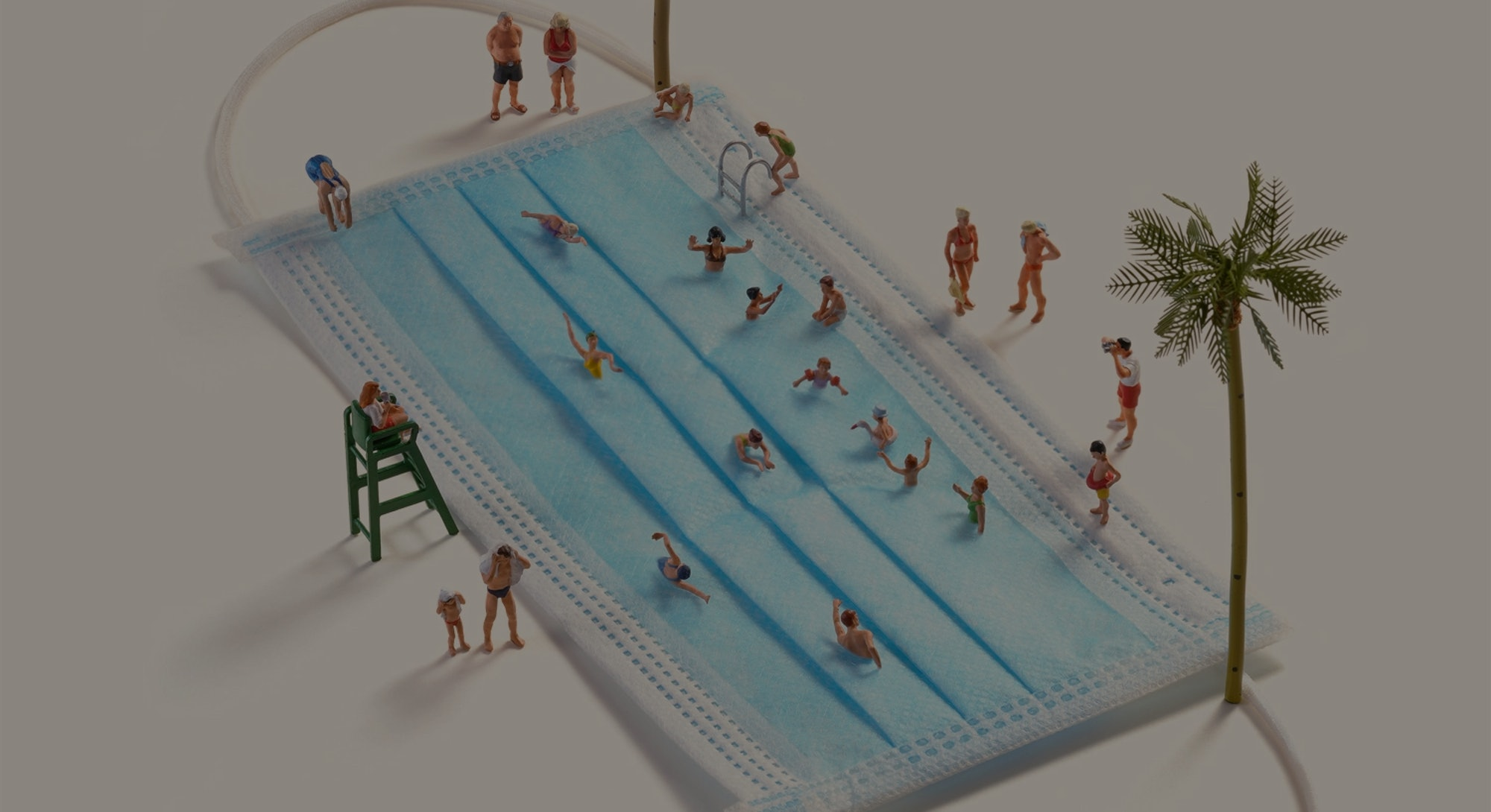 Tatsuya Tanaka used a blue face mask and human figurines to create a miniature pool scene.