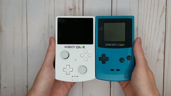 A photo of the WiiBoy Color and the Game Boy Color side by side.