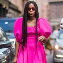 Editor wears pink dress at Fashion Week