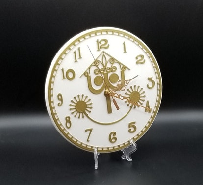 It's a Small World Inspired Wall Clock