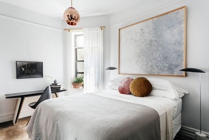 You can refresh your bedroom for summer with new linens and greenery