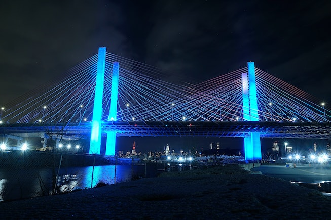The Kosciuszko Bridge is illuminated in blue as part of the #LightItBlue for Health Workers movement on April 09, 2020 in New York City. Landmarks and buildings across the nation are displaying blue lights to show support for health care workers and first responders on the front lines of the COVID-19 pandemic.