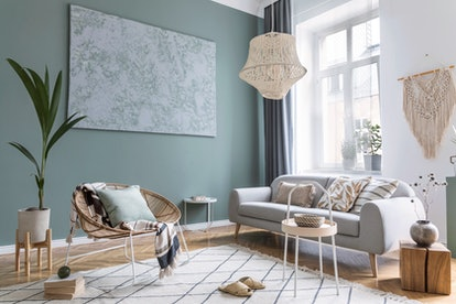 Refresh your living room for summer with bright wall colors and new accent chairs