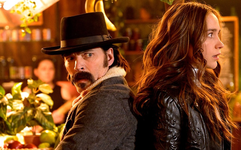Tim Rozon as Doc Holliday, Melanie Scrofano as Wynonna Earp in Season 4