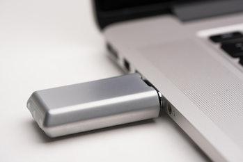 Crave's Duet Pro vibrator plugged into a laptop USB port