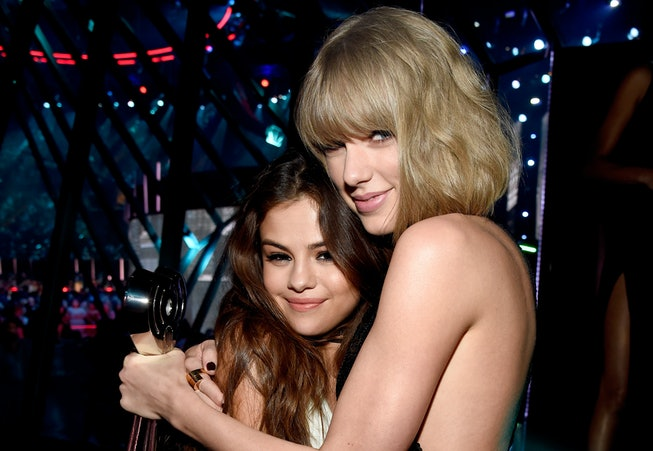 Recording artists Selena Gomez (L), winner of the 'Biggest Triple Threat' award, and Taylor Swift, winner of the 'Best Tour' award, backstage at the iHeartRadio Music Awards which broadcasted live on TBS, TNT, AND TRUTV from The Forum on April 3, 2016 in Inglewood, California.