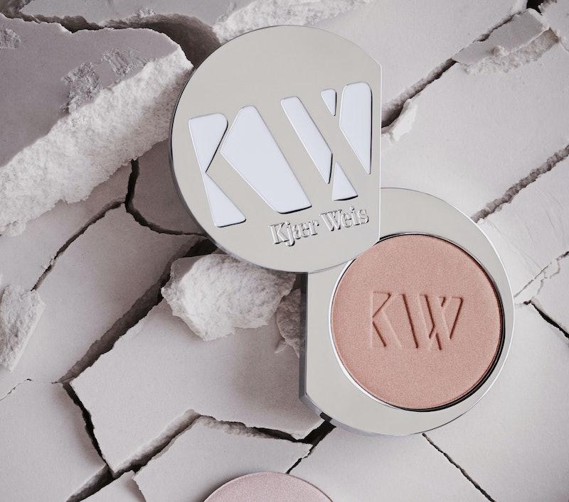Kjaer Weis' new LighSlip Powder Highlighter mimics the effect of natural light beams on your face
