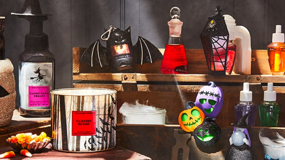 An image of a multitude of Bath and Body Works Halloween products, such as a vampire blood candle, scent diffusers, and bat sanitizer holders.